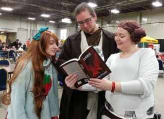 Fans at Regina's Fan Expo 2016, reading Hawk