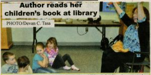 Marie reading her books the Assiniboia Library